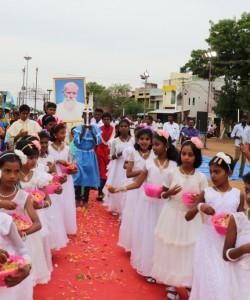 Children offering flowers
